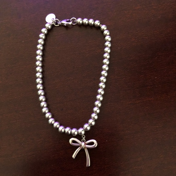 a1dd183663a4 AUTHENTIC Tiffany   Co silver bow bracelet. M 5a8f25fc2c705dd02a269b0d